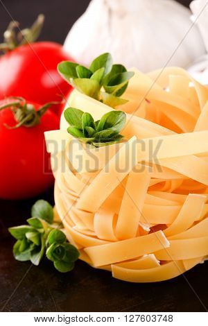 Portion Of Fettuccine Pasta With A Strig Of Oregano