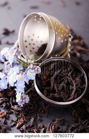 Strainer Full Of Dry Tea Leaves With Blue Flower