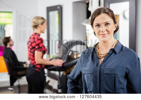 Portrait Of Confident Beautician In Shop