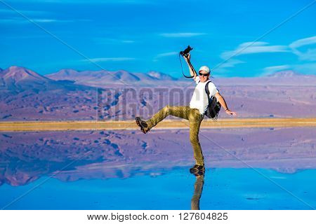 Photographer on a exotic place in Atacama Desert, Chile