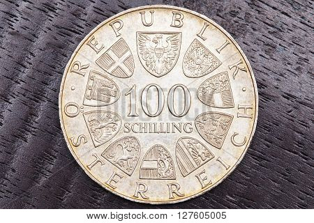 One hundred Austrian shillings on black background