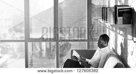 Businessman Reading Magazine Relaxation Concept