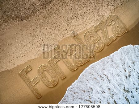 Fortaleza written on the beach