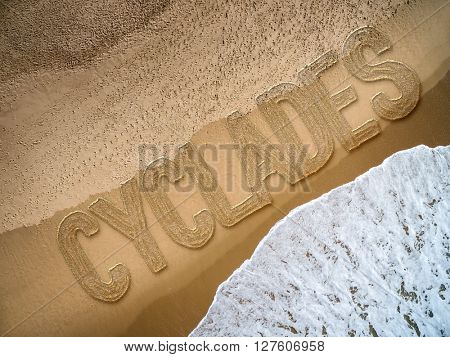 Cyclades written on the beach