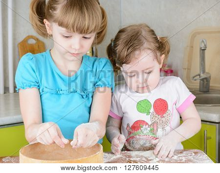 Two Sisters Sifts The Flour For Dough
