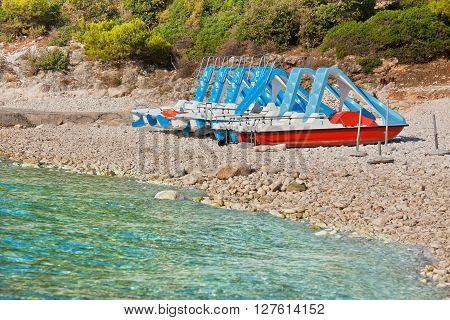 Multicolored catamarans on the pebbles beach in Croatia