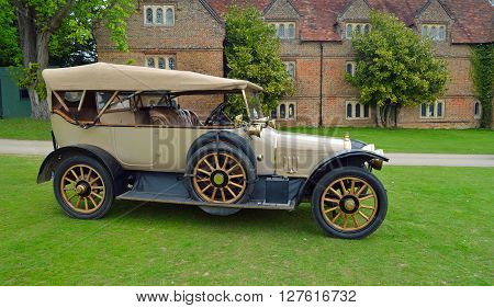 Saffron Walden, Essex, England - April 24, 2016: Vintage 1914 Sunbeam Motor car in front of old building.