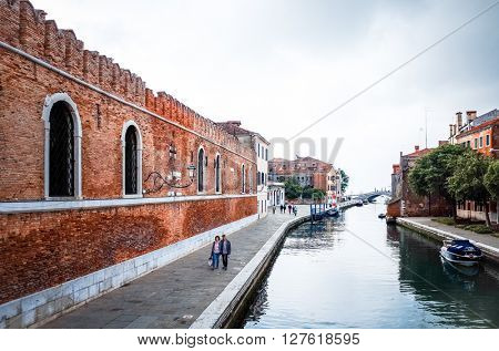 Tourists on water street with Gondola in Venice on May 26, 2015. its entirety is listed as a World Heritage Site, along with its lagoon.May 26 VENICE, ITALY