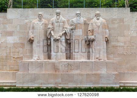 Sculptures of four Calvinism's main proponents at center of Refomation Wall Parc Des Bastions Geneva Switzerland. Guillaume Farel Jean Calvin Theodore de Beze John Knox
