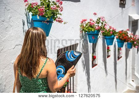Young spanish woman with fan .Europe .