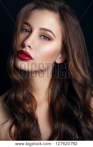 High fashion look.glamor closeup portrait of beautiful sexy stylish brunette young woman model with bright makeup with red lips.Beautiful girl with red lips on black Background. Gorgeous Woman Face.