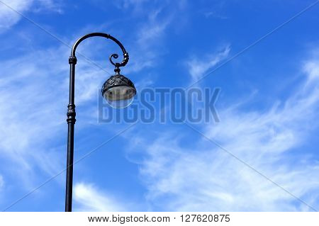 Street lamp on background of blue sky