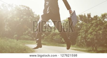 Business Man Forest Nature Jumping Concept