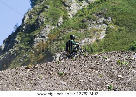 SOCHI, RUSSIA  AUGUST 16, 2014: Off-road motorcycle rider in summer mountains