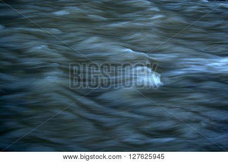 Turbid River Flow. Cold Spring Stream. Muddy water.