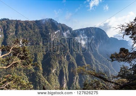 Beautiful View on the Emei mountain in the morning with sunlight and mist. It is a famous buddhist moutain located near Chengdu Sichuan Province China