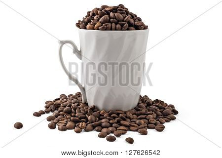 White coffee cup and spilled coffee-beans isolated on white