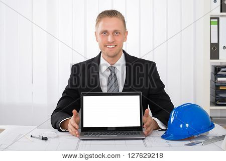 Architect Showing His Laptop Over Blue Print