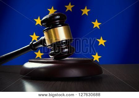 Wooden Gavel With European Union Flag In Background