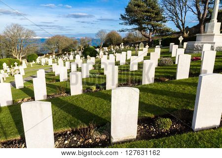 Backs of white graves at military naval cemetery Portland Bill Dorset England UK.