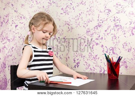 Little Girl Drawing With Pencils At Table
