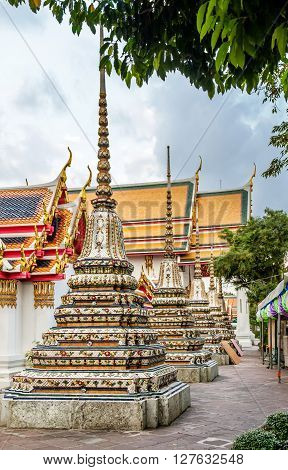 Classical Thai architecture in Wat Pho public temple Bangkok Thailand. Wat Pho known also as the Temple of the Reclining Buddha. ** Note: Soft Focus at 100%, best at smaller sizes