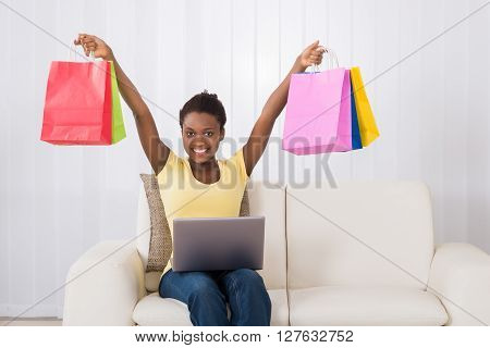 Woman Holding Multi-colored Shopping Bags