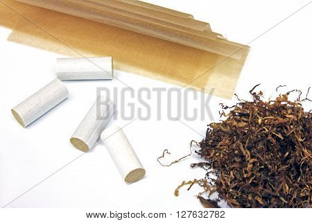 Tobacco filter tips and riice papers isolated on white background