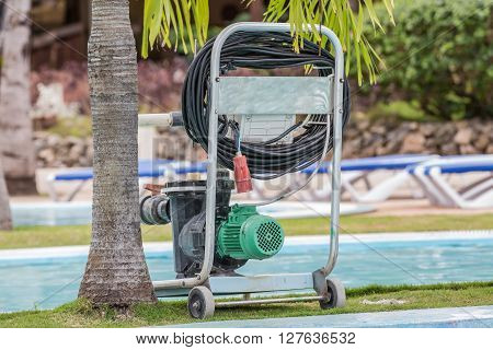 nice amazing closeup view of old technology electrical pump for cleaning swimming pool