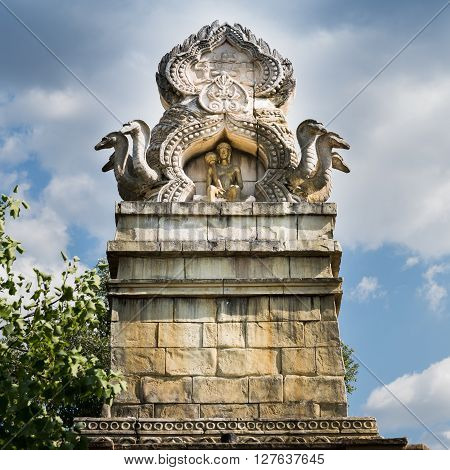 Top of an Indian temple carved with human figures and cobras.