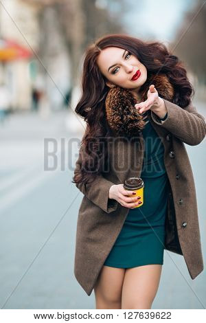 Close-up Funny image of laughing woman, emotional crazy smiling beautiful teen girl, emotional model in bright hipster casual cloth, swag, laughing girl, playful mood, Cold season.Red lipstick smile, cool.