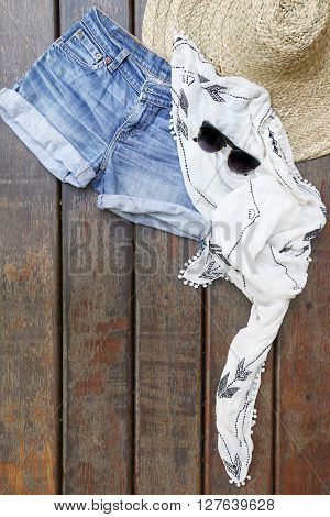 Summer music festival outfit on the wooden background