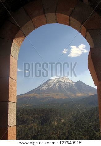 A view of Popocatepetl volcano from a church in Iztaccihuatl volcano Puebla, Mexico