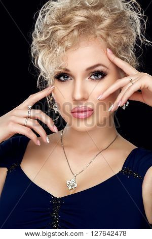 Spa, beauty, skincare, wellness and health. Glamour close-up portrait of beautiful woman model face with purity healthy skin and gold make-up and french manicure
