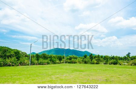 Landscape Of Green Meadow With Blue Sky And Mountain At Country Side Thailand