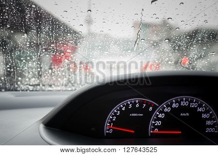 Cloae up Rain drops on windshield car