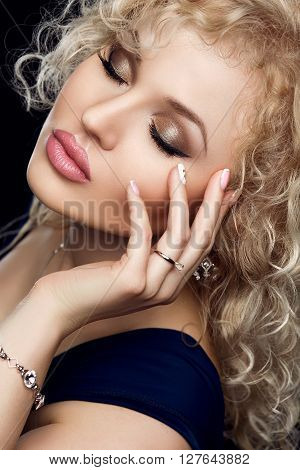 Style, fashion, manicure, cosmetics and make up. Beautiful plump lips makeup and nail manicure closeup portrait of female model with pink lipstick, clean nails and clean skin. Shiny curly hairstyle