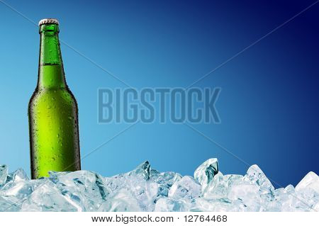 cold beer bottle with water droplets on surface