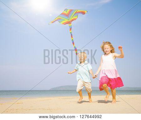Children running on the beach.