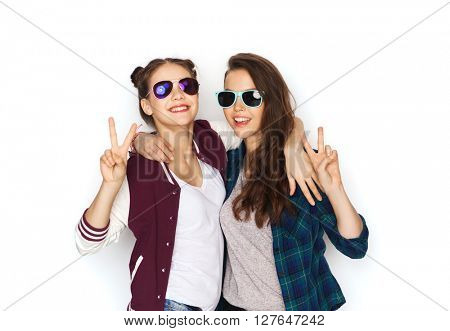people, friendship, fashion, summer and teens concept - happy smiling pretty teenage girls in sunglasses showing peace hand sign