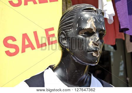 India face of damaged male mannequin in street