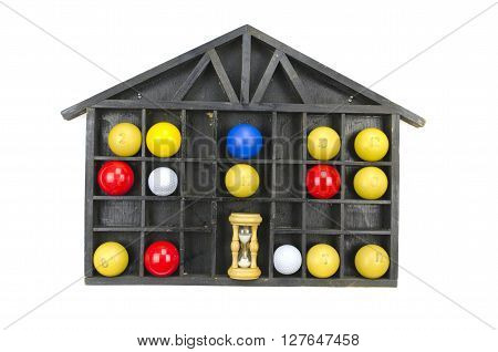 Multicolored billiard balls and sand clock in black wooden shelf