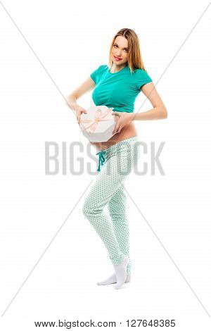 Beautiful pregnant woman holding a gift around the abdomen, it is unknown who the girl or the boy. Happy mom. The concept of pregnancy.The concept of motherhood