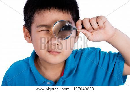 Asian Chinese Boy Holding Magnifying Glass