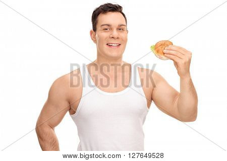 Cheerful young guy holding a sandwich and looking at the camera isolated on white background