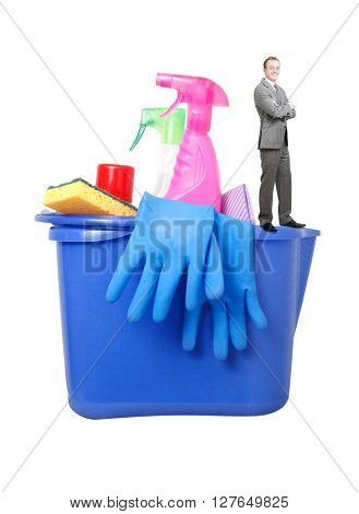 Businessman with cleaning products on white