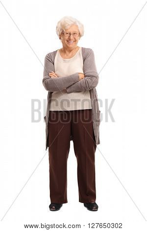 Full length portrait of a content senior lady smiling and looking at the camera isolated on white background