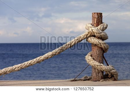 Rope on seafront and cloudy sky in autumn. Turkey Erdek coast of Marmara.