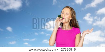 people, holidays and celebration concept - happy young woman or teen girl in pink dress and party cap over blue sky and clouds background