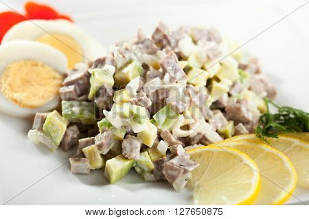 Olivier Russian Salad Dressed with Lemon Slice and Egg